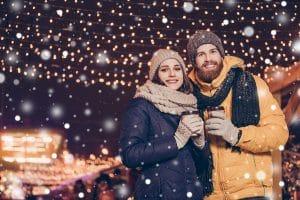Young couple walking in Bentleyville enjoying hot chocolate