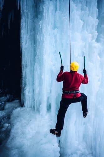 winter ice climbing a waterfall