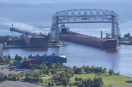 A ship entering a harbor on Lake Superior.