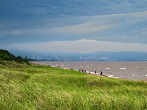 Summer at Park Point Beach On Lake Superior With Duluth, Minnesota In Back