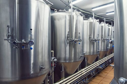brewery tours with lines of metal tanks