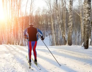 Training on cross-country skis in the winter forest on Spirit Mountain Duluth