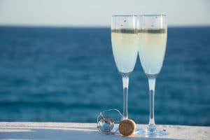 Two glasses with champagne with view of Lake Superior during a Bed and Breakfast Duluth MN stay